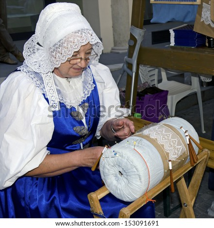 BRATISLAVA, SLOVAKIA - AUGUST 31, 2013 - The woman in traditional outfit from Brezova pod Bradlom is demonstrating the bobbin lace during Festival Craftsmen Days  August 31th 2013 in Bratislava