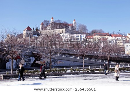 BRATISLAVA, SLOVAKIA - FEBRUARY 3, 2015: City view with Bratislava castle on the hill, Bratislava, Slovakia. Bratislava is the capital and most visited city in Slovakia. - stock photo