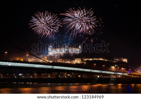 BRATISLAVA, SLOVAKIA - JANUARY 1: New Year fireworks above Danube river on January 1, 2013 in Bratislava, Slovakia - stock photo