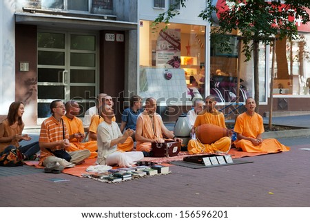 BRATISLAVA, SLOVAKIA - JULY 22: Members of Hare Krishna sit and sing on one of the central streets of Bratislava, Slovakia July 22, 2013