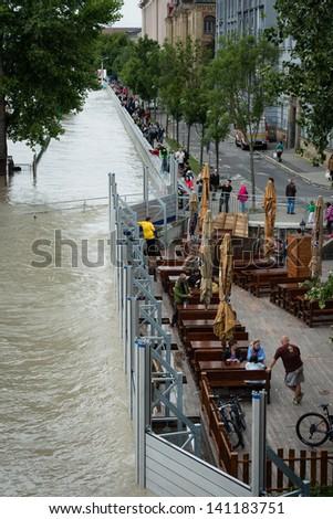 BRATISLAVA, SLOVAKIA - JUNE 5:  People at Vajanskeho Embankment watch as water of the Danube river is rising on June 5, 2013 in Bratislava - stock photo
