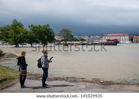 BRATISLAVA, SLOVAKIA - JUNE 4:  People watch as water of the Danube river is  rising on June 4, 2013 in Bratislava - stock photo