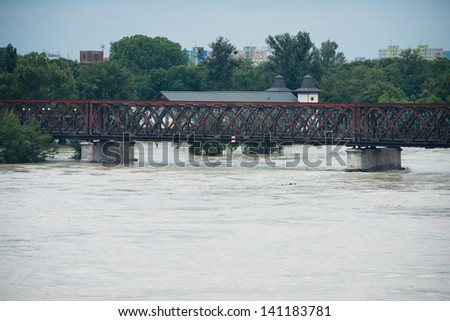 BRATISLAVA, SLOVAKIA - JUNE 5:  Rising water of Danube on Petrzalka sidewith the Old bridge on June 5, 2013 in Bratislava - stock photo