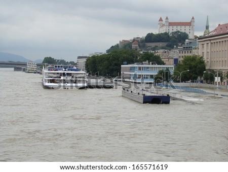 Bratislava, Slovakia - June 5: The water of Danube river flooded the personal harbor on Fajnorovo Embankment in Bratislava on June 5th, 2013 - stock photo