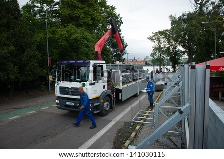 BRATISLAVA, SLOVAKIA - JUNE 4:  Workers are preparing flood barricades on the Petrzalka side of the Danube on June 4, 2013 in Bratislava - stock photo