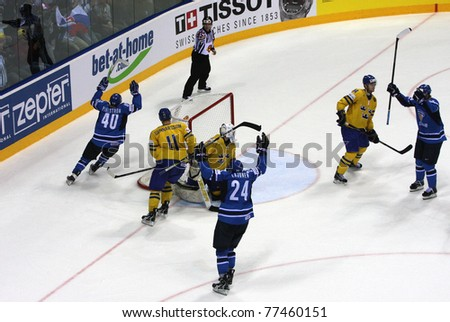 BRATISLAVA, SLOVAKIA - MAY 15: Finnish ice hockey players celebrate goal in the gold medal game of World Cup. They beat the Swedish team 6-1 on May 15, 2011 in Bratislava, Slovakia. - stock photo