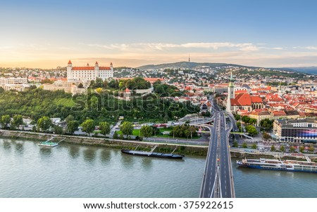 Bratislava, Slovakia - Panoramic View with the Castle and Old Town at Sunset as Seen from Observation Deck - stock photo