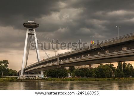 BRATISLAVA, SLOVAKIA - SEPTEMBER 20:The  Novy Most Bridge across the Danube River in Bratislava, Slovakia on SEPTEMBER 20 - stock photo