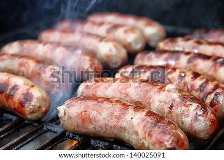 Bratwurst sausages on grill. - stock photo