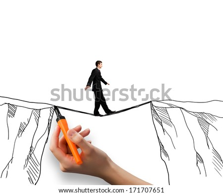 Brave businessman walking on rope above mountain gap - stock photo