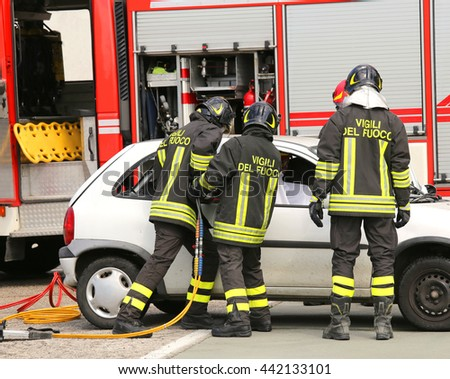brave firefighters relieve an injured after an accident during a practice session in the fire station