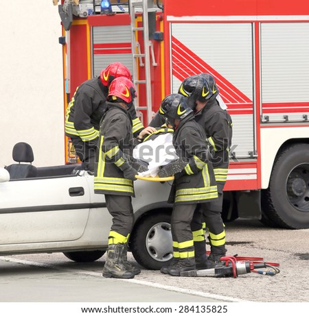 brave firefighters relieve an injured after car accident