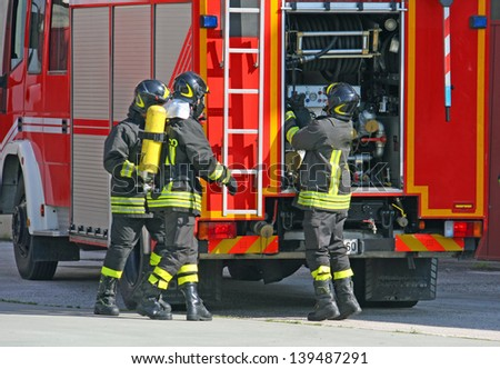 brave firefighters with oxygen tank fire during an exercise held to extinguish the fire in a House - stock photo