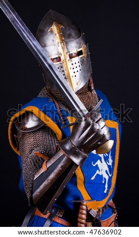 Brave knight is ready for battle - stock photo