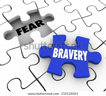 Bravery word on a puzzle piece about to fill the word Fear conquering adversity and being bold and courageous to overcome a challenge - stock photo