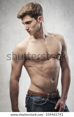 Brawny bare-chested young man - stock photo