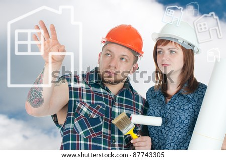 Brawny building contractor and female architect discussing the model of a future house, over a sky background