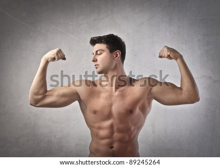 Brawny man showing his muscles