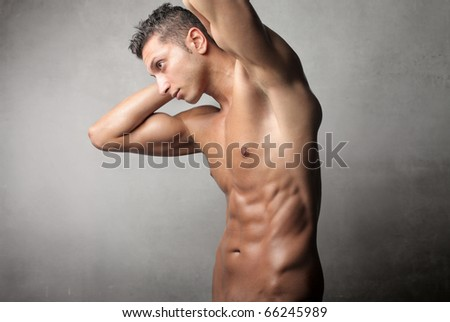 Brawny man showing his torso - stock photo