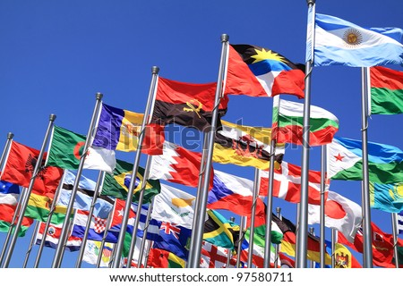 Brazil and world national flags is flying - stock photo