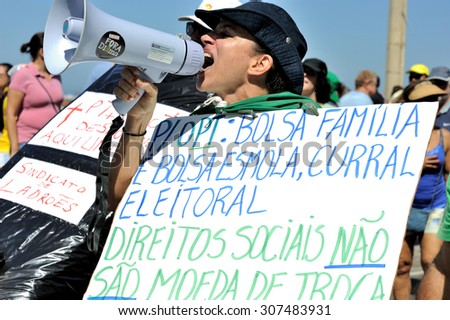 Brazil - August 16, 2015: A protester shouts anti-government slogans during a protest in Copacabana Beach, in Rio de Janeiro. - stock photo