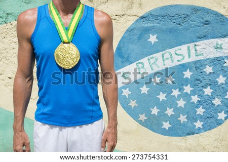 Brazil champion first place athlete wearing a gold medal standing in front of a Brazilian flag mural Rio de Janeiro - stock photo