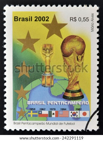 BRAZIL - CIRCA 2002: a stamp printed in Brazil showing an image of the World Cup trophy and the years that Brazil won the World Cup, circa 2002.  - stock photo