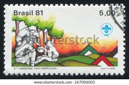 BRAZIL - CIRCA 1981: stamp printed by Brazil, shows  Boy Scout and Campfire, circa 1981 - stock photo