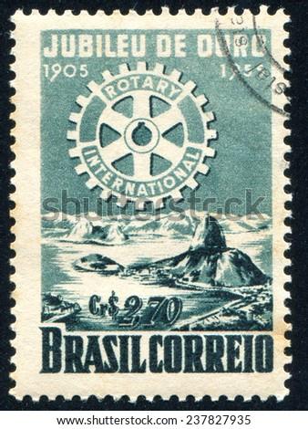 BRAZIL - CIRCA 1955: stamp printed by Brazil, shows  Rotary Emblemo and Bay of Rio de Janeiro, circa 1955 - stock photo