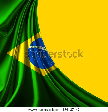 Brazil flag fabric and yellow background - stock photo