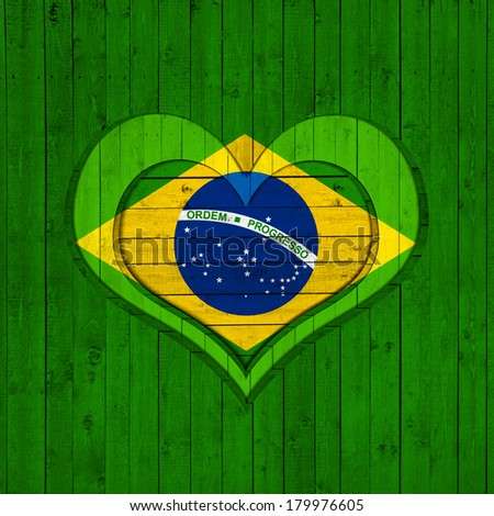 Brazil flag heart and wood background - stock photo