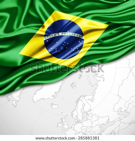 Brazil flag of silk and world map background - stock photo