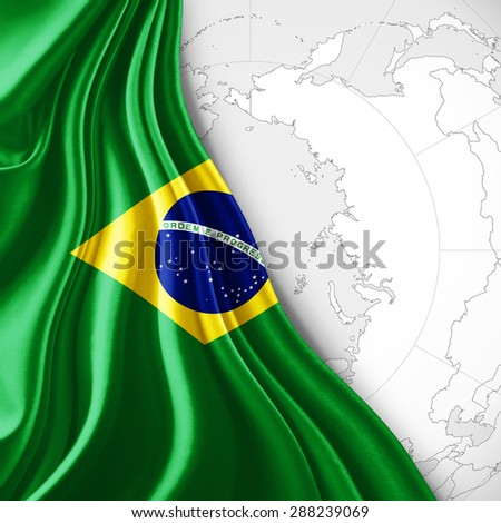 Brazil  flag of silk with world map and white background - stock photo