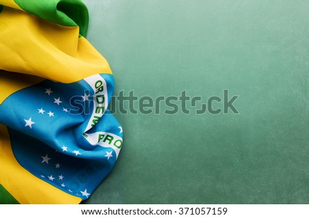 Brazil flag on a chalkboard with copy space - stock photo