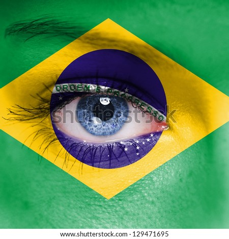Brazil flag on woman face - stock photo