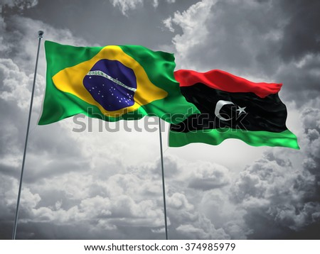 Brazil & Libya Flags are waving in the sky with dark clouds - stock photo