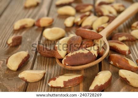Brazil nut on brown background - stock photo