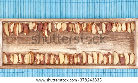 Brazil nuts on a wooden background. - stock photo