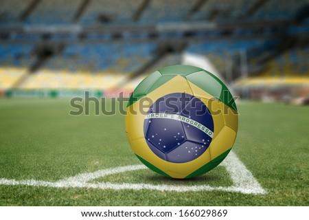 Brazil soccer ball on the soccer field - stock photo