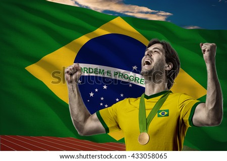 Brazilian Athlete Winning a golden medal in front of a brazilian flag.