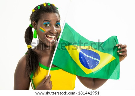 Brazilian black woman dressed in green and yellow, holding a flag of Brazil.