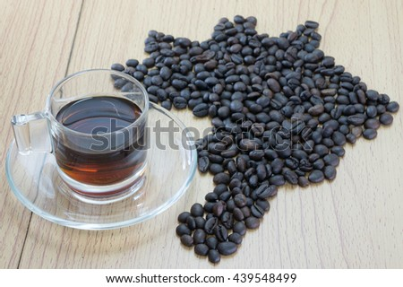 Brazilian coffee map on wooden background  - stock photo