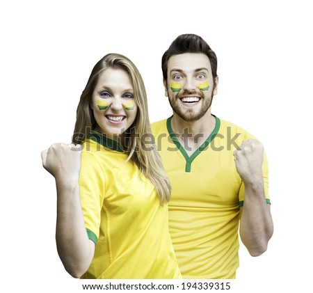 Brazilian couple fan celebrate on white background - stock photo