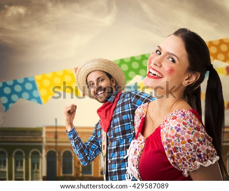 Brazilian couple having fun in the Junina Party