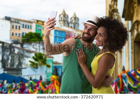 Brazilian couple taking a selfie photo in Bahia, Brazil