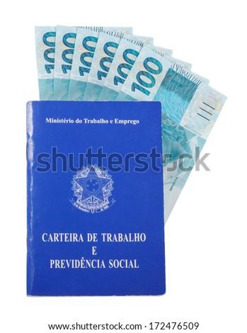 Brazilian document work and social security (Carteira de Trabalho e Previdencia Social) filled with brazilian money - stock photo
