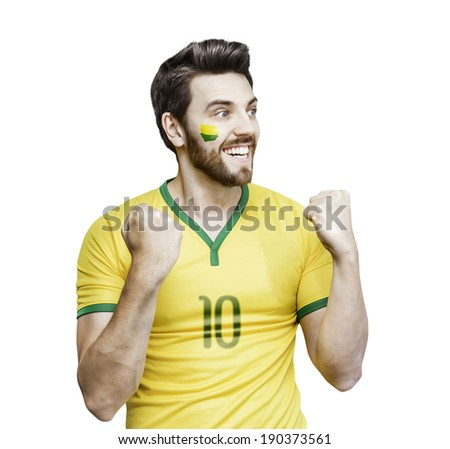 Brazilian fan celebrates on the white background - stock photo
