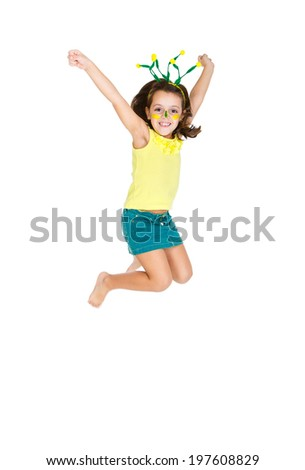 Brazilian fan Kid jumping and supporting Brazil for popular sports competitions, like soccer, volleyball and olympics. - stock photo
