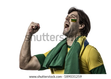 Brazilian fan with paint on his face celebrating on a white background. - stock photo
