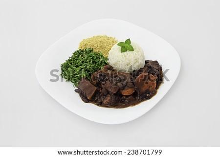 Brazilian Feijoada dish on a white background. - stock photo